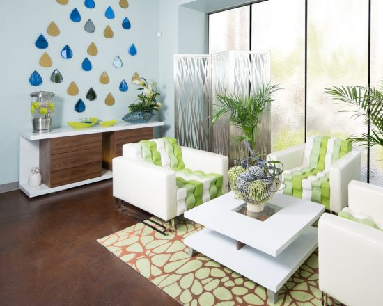 Enhance your living room interior design with the warmth and beauty of greens